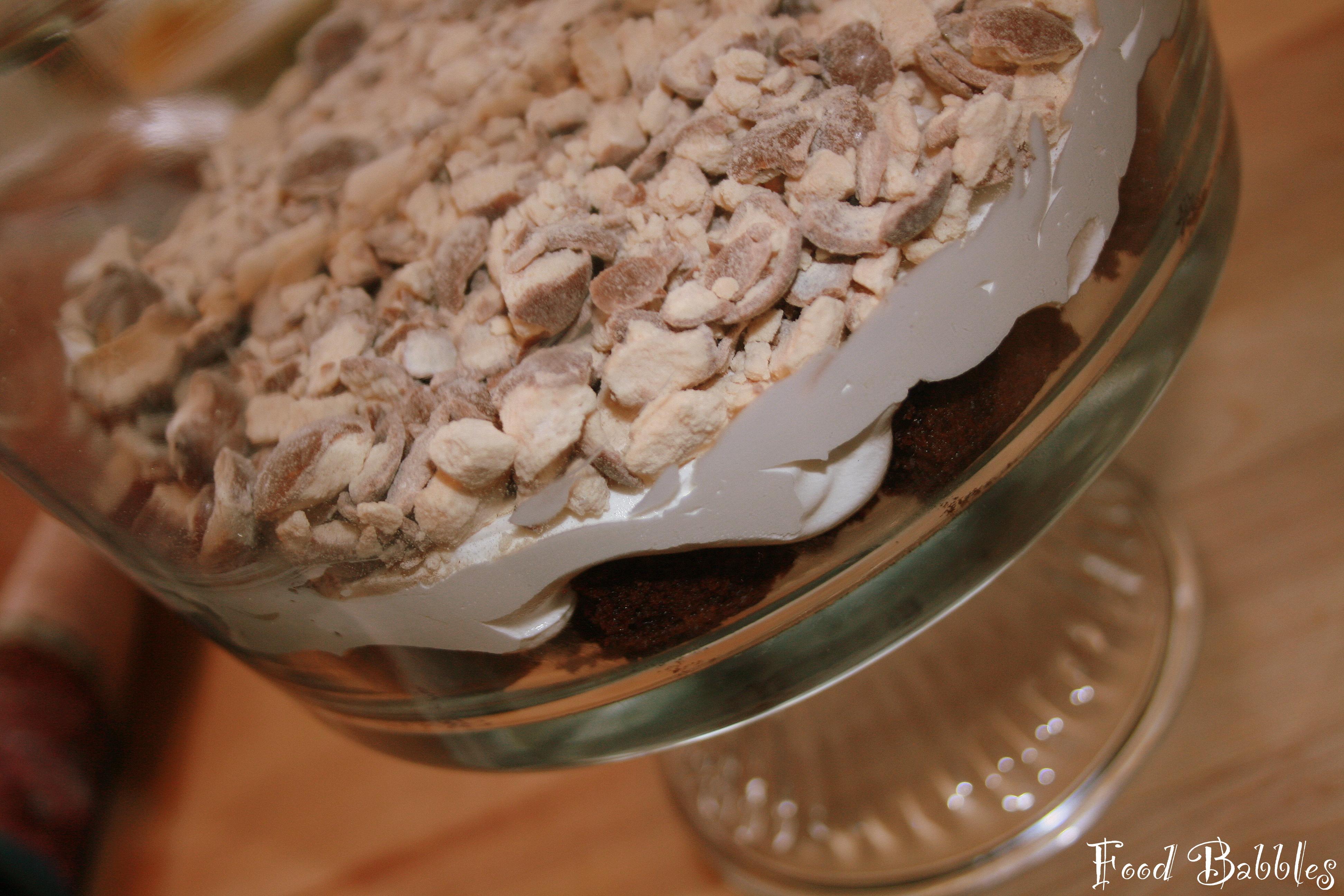 Cake, whipped cream, Whoppers... making something delightful!